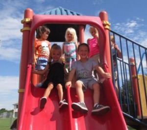 LRHS Mini Mustangs enjoy time outside in the school's playground