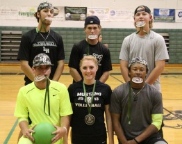 The 2015 LRHS dodgeball champions enjoy the sweet taste of success.