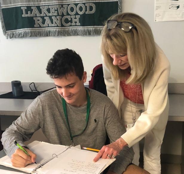 LRHS math teacher Ann Johnson assists sophomore Luke French