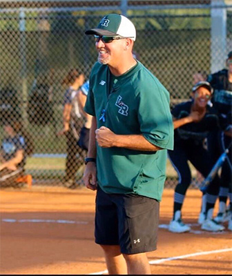 LRHS softball coach TJ Goelz roots for the Mustangs.
