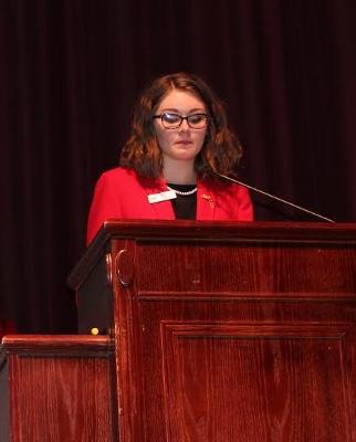 LRHS senior Morgan Kirchman addresses and audience.